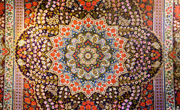 Central fragment of beautiful oriental persian carpet with colorful texture. Pattern with leaves and flowers Royalty Free Stock Image