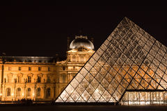 Central gate - pyramid of Louvre. PARIS - MAY 11: The central entrance to the Louvre by night. May 11, 2008 in Paris, France Stock Images