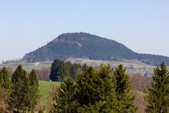 Central German Uplands. On easter springtime holiday with blue sky and green fields forest trees Royalty Free Stock Photos