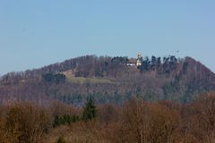 Central German Uplands. On easter springtime holiday with blue sky and green fields forest trees Stock Photography