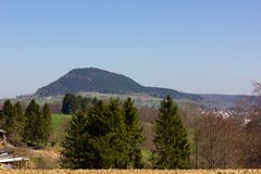 Central German Uplands. On easter springtime holiday with blue sky and green fields forest trees Stock Photo