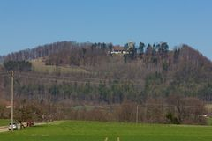 Central German Uplands. On easter springtime holiday with blue sky and green fields forest trees Stock Photos