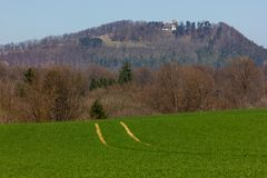 Central German Uplands. On easter springtime holiday with blue sky and green fields forest trees Royalty Free Stock Photo
