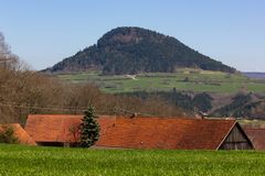 Central German Uplands. On easter springtime holiday with blue sky and green fields forest trees Royalty Free Stock Photography