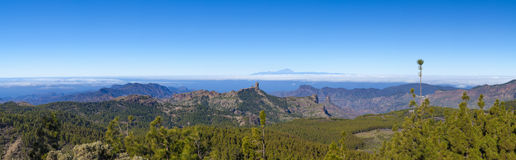 Central Gran Canaria in January. View from the highest point of the island, Pico de Las Nieves, across Caldera de Tejeda towards Teide on Tenerife. Both Roque Stock Photos