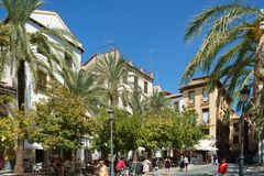 Granada, Spain - September 13th 2017: A typical Plaza in central Granada, Spain. Central Granada is typified by narrow streets and small plazas. Many squares are Stock Images