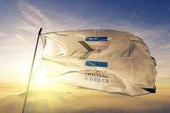 Central Greece Region logo of Greece flag textile cloth fabric waving on the top sunrise mist fog. Beautiful vector illustration