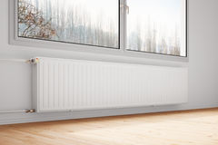 Central heating attached to wall. With closed windows Royalty Free Stock Photography