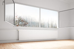 Central heating attachted to wall. With open windows Royalty Free Stock Images