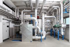 Central heating and cooling system control in a boiler room. Pumps and pipes stock photos