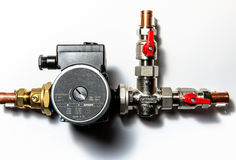 Central heating manifold. Over white wall Royalty Free Stock Photos
