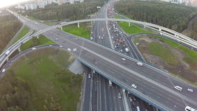 Central highway and overpasses, aerial view. Aerial shot of transport on multilevel intersection in the city. Traffic jam on central motorway stock video footage
