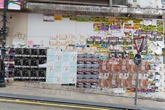 Central, Hong Kong - CIRCA April,2018: advertisement posters on wall . Real estate advertising posters in Hong Kong China Royalty Free Stock Image