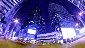 Central. Hong Kong City Night Timelapse. Wide Shot. City timelapse at night. Central of Hong Kong. Corporate Buildings with busy traffic across the main road at stock footage