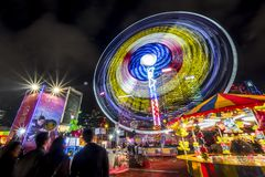 People playing games in a large carnival in the heart of financial center of Asia. Royalty Free Stock Photos