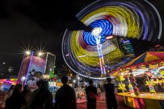 People playing games in a large carnival in the heart of financial center of Asia. Royalty Free Stock Image