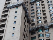 Central, Hong Kong - 1 November 2017: scaffolding of bamboo provide a platform for high-altitude maintenance work at several. Apartments royalty free stock photo
