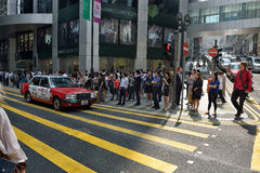 Central in Hong Kong. People waiting for crossing the Street in Central District, Hong Kong Royalty Free Stock Image