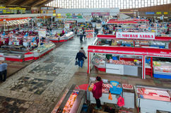 Central indoor food market, top view, Gomel, Belarus. GOMEL, BELARUS - APRIL 27, 2017: Unknown people visit Central covered food market, Gomel, Belarus stock photography