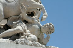 Central Lisbon Statue Detail. Of a man being run over by a horse Royalty Free Stock Photos