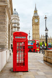 Central London, England. Red phone booth, double decker buses and Big Ben. London, England royalty free stock photography