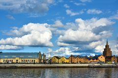 Riga Centralmarket at river banks of Daugava. Central market in Riga at the river banks of Daugava, Latvia. The market is located in the old zeppelin halls royalty free stock image