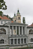 Central Market and Saint Nicholas Cathedral. Ljubljana, Slovenia. Royalty Free Stock Photo