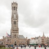 Central market square and Belfort tower in Bruges Belgium stock image