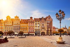 Central market square in Wroclaw Poland with old colorful houses, street lantern lamp and walking tourists people. Central market square in Wroclaw Poland with royalty free stock photography