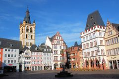 Central market Trier with colored houses and Gothi. Central market square Trier with colored German houses and Gothic church St. Gangolf with yellow tower Stock Photos
