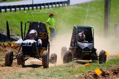 CENTRAL MICHIGAN UNIVERSITY BAJA. MACHINE NUMBER  30 LEADS ANOTHER COMPETITOR THROUGH ROUGH PARTS OF THE TRACK Stock Photography