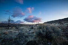 Central Oregon för Oregon ökensoluppgång Arkivbild