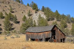 Central Oregon Ranch Building Falling Apart. This is a ranch building in Central Oregon left to fall apart under a blue sky Royalty Free Stock Photos