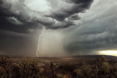 Central Oregon Strike. A dramatic lighting strike in Central Oregon (Bend, OR) during a recent Summer thunder storm in 2014 Royalty Free Stock Photo