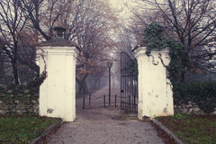 Central park alley vintage entrance with towers and iron gates o Royalty Free Stock Photo