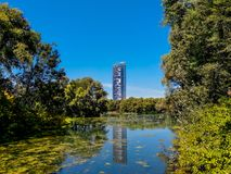 Central Park Autumn and buildings reflection over the lake in Rheinaue park in the city of Bonn royalty free stock images