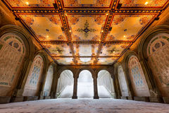 Central Park Bethesda Terrace Arcade with Illuminated Tile Ceiling, NYC. Low angle view of the Bethesda Terrace Arcade during a winter snowstorm with illuminated Stock Image