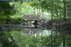 Central Park Bridge. View of crosstimbered wooden bridge in the North Woods section of Central Park in New York City Stock Photography