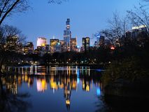 Central Park in dusk and midtown Manhattan Royalty Free Stock Image