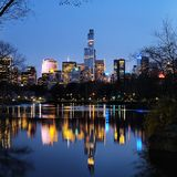 Central Park in dusk and midtown Manhattan Royalty Free Stock Photography