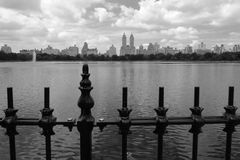 Central Park. Fence with lake and buildings in Tue background Royalty Free Stock Photography