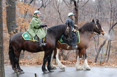 Central Park Horse Patrol. The New York City Parks Enforcement Mounted Auxiliary Unit is composed of volunteer equestrians who patrol the park to give royalty free stock image