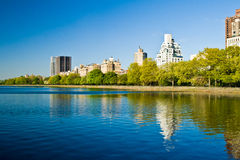 Central Park Lake, New York City, United States of America. Central Park Lake, with manhattan skyscrapers behind, New York City, United States of America Royalty Free Stock Photo