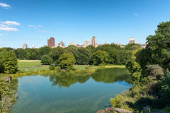 Central Park Lake and NYC Skyline in Distance Royalty Free Stock Images