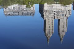 Central Park Lake Surface. Reflection of apartment buildings on Central Park West from the lake in central park during a sunny morning. Focus point is on the Stock Photo