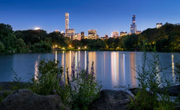 Central Park Lake at twilight with skyscrapers. New York City Stock Photography