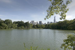 Central Park Lake. This is a view across Central Park Lake to the southern skyline of Manhatten Stock Photography