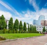 Central park landscape with modern building. Stock Image