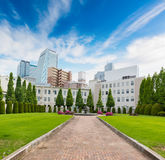 Central park landscape with modern building. Stock Photo