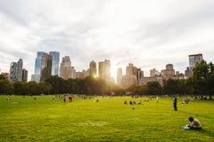 Central Park-Leben in New York bei Sonnenuntergang Stockfotos